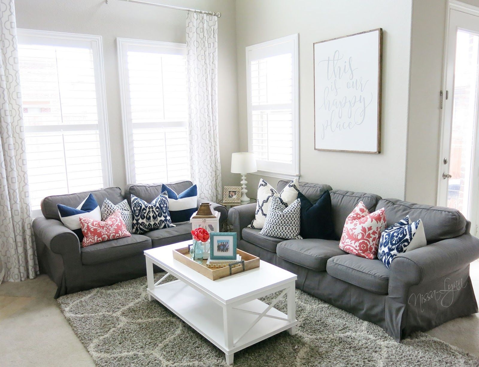 A Fresh Living Room With Pops Of Colors Navy Aqua Gray And Coral  Living Room Grey Living